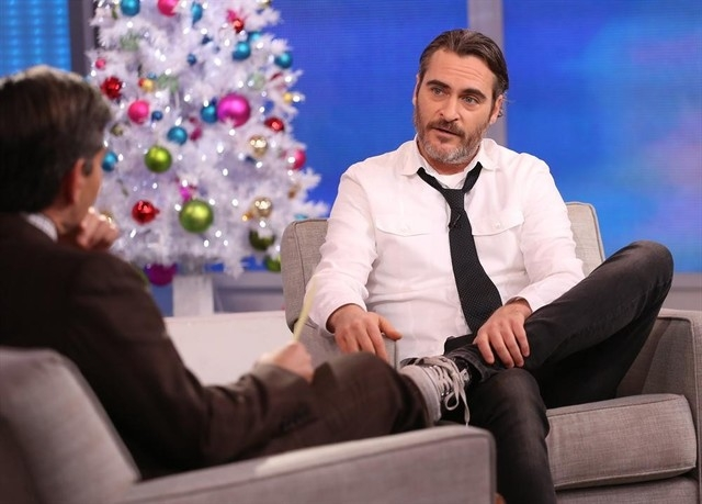 """Actor Joaquin Phoenix appears on """"Good Morning America"""" with George Stephanopoulos, left, on ABC, Tuesday, Dec. 9, 2014, in New York. Phoenix announced his """"engagement"""" on """"Late Show with David Le ..."""