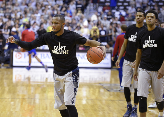 "Georgetown guard Jabril Trawick, left,  wears an ""I Can't Breathe"" t-shirt during warm ups before NCAA college basketball game against Kansas, Wednesday, Dec. 10, 2014, in Washington. (A ..."