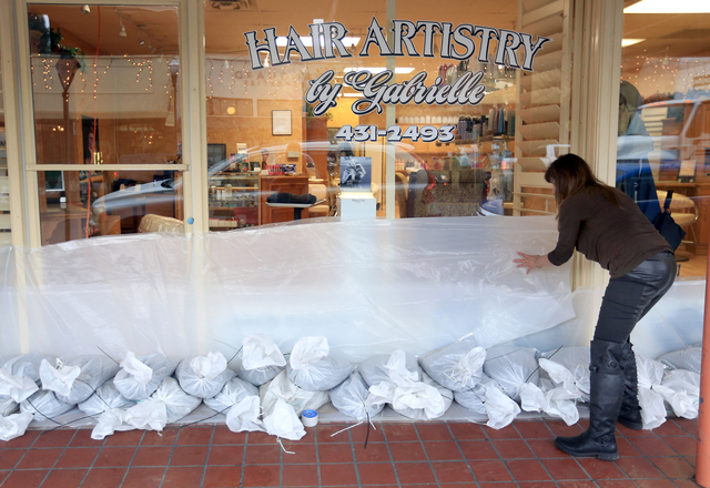 Sandbags are brought in to help protect businesses, Wednesday Dec. 10, 2014 in Santa Rosa, Calif. Northern California residents are bracing for a powerful storm that could be the biggest in five y ...