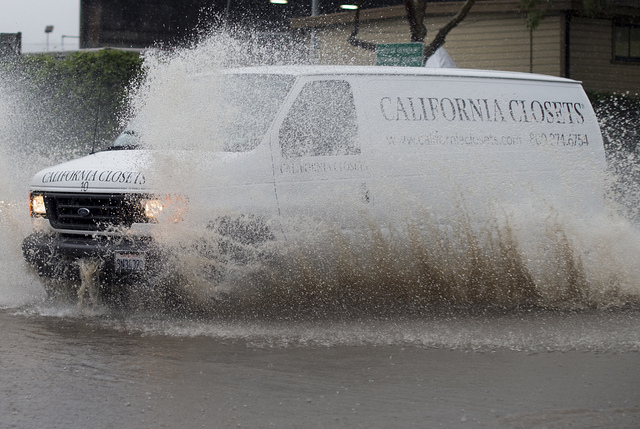 A van navigates a flooded roadway in Berkeley, Calif., on Thursday, Dec. 11, 2014. A powerful storm churned through Northern California Thursday, knocking out power to tens of thousands and delayi ...