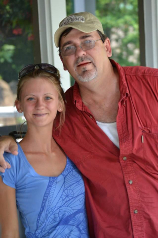 This undated photograph released by the families of Jessica Chambers and her sister Amanda Prince shows Jessica Chambers and her father Ben Chambers taken in Courtland, Miss. Mississippi authoriti ...