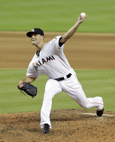In this Sept. 18, 2014, file photo, Miami Marlins relief pitcher Dan Jennings (43) pitches against the Washington Nationals during a baseball game in Miami. Dan Jennings traded Dan Jennings. On th ...