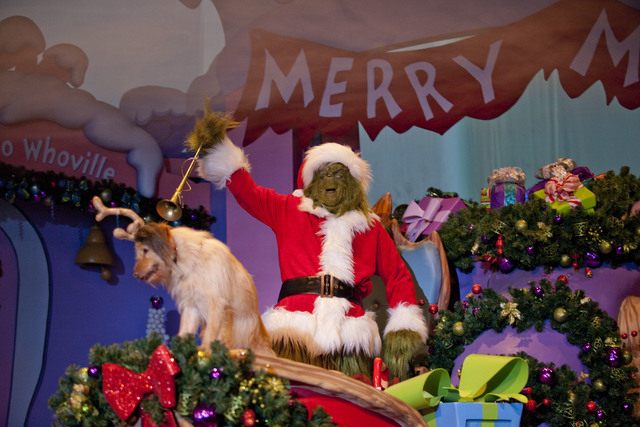 This undated photo provided by NBCUniversal Orlando shows the Grinch from the theme parks Wholiday Spectacular, in Orlando, Fla. The holiday attraction is themed on Dr. Seuss classic How the Grinc ...