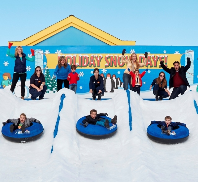 This undated photo provided by LEGOLAND in Carlsbad, Calif., shows families enjoying the theme parks Holiday Snow Days. The attraction includes snow-covered tube runs where kids can play, slide an ...