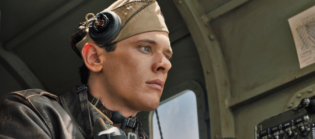 "In this image released by Universal Pictures, Jack O'Connell portrays Olympian and war hero Louis ""Louie"" Zamperini in a scene from ""Unbroken."" The film, directed by Angelina J ..."