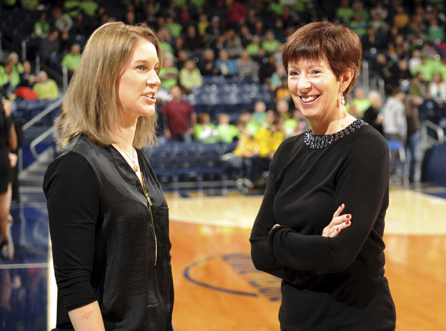 Notre Dame coach Muffet McGraw, right, and former player Megan Duffy, left, talk before an NCAA basketball game Saturday, Dec., 13, 2014 in South Bend, Ind. Duffy is currently an assistant coach w ...