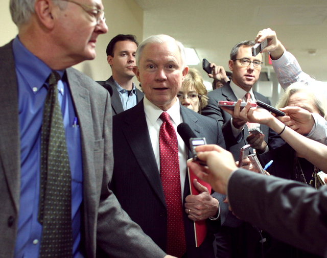 Sen. Jeff Sessions, R-Alabama talks to reporters on Capitol Hill in Washington, Friday, Dec. 12, 2014, as the Senate considers a spending bill. The House has passed an additional stopgap spending  ...