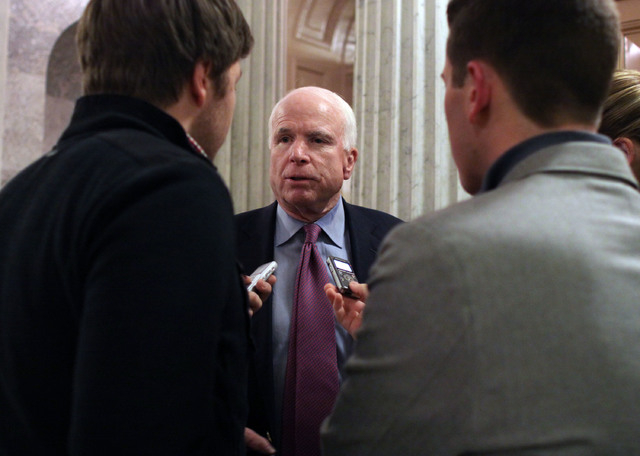 Sen. John McCain (R-AZ) talks with reporters after the Senate voted on a $1.1 trillion spending bill to fund the government through the next fiscal year on on Saturday, December 13, 2014 on Capito ...