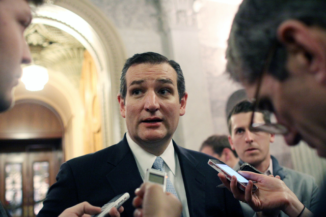 Sen. Ted Cruz (R-TX) talks with reporters after the Senate voted on a $1.1 trillion spending bill to fund the government through the next fiscal year on on Saturday, Dec. 13, 2014 on Capitol Hill  ...