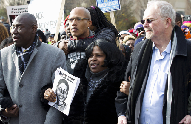 Samaria Rice center, the mother of Tamir Rice, the 12-year old boy who was fatally shot by police officer in Cleveland, and others, march in Pennsylvania Avenue toward Capitol Hill in Washington,  ...
