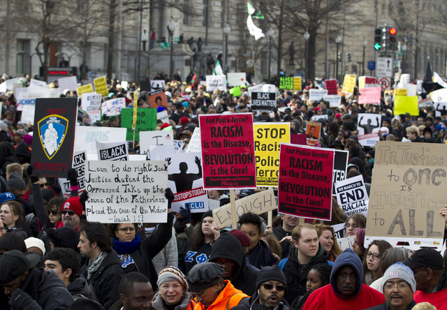 Demonstrators march on Pennsylvania Avenue toward Capitol Hill in Washington, Saturday, Dec. 13, 2014, during the Justice for All rally. More than 10,000 protesters are converging on Washington in ...