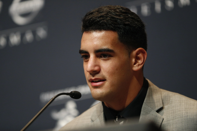 Oregon quarterback Marcus Mariota talks during a news conference prior to the announcement of the Heisman Trophy winner, Saturday, Dec. 13, 2014, in New York. (AP Photo/Julio Cortez)