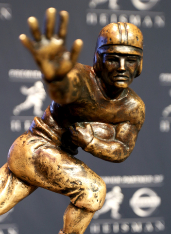 The Heisman Trophy is displayed prior to the announcement of the winner, Saturday, Dec. 13, 2014, in New York. The trophy will be awarded to one of the three finalists who are Wisconsin running ba ...