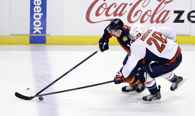Florida Panthers left wing Tomas Fleischmann (14) drives against Washington Capitals right wing Troy Brouwer (20) during the first period of an NHL hockey game, in Sunrise, Fla., Tuesday, Dec. 16, ...