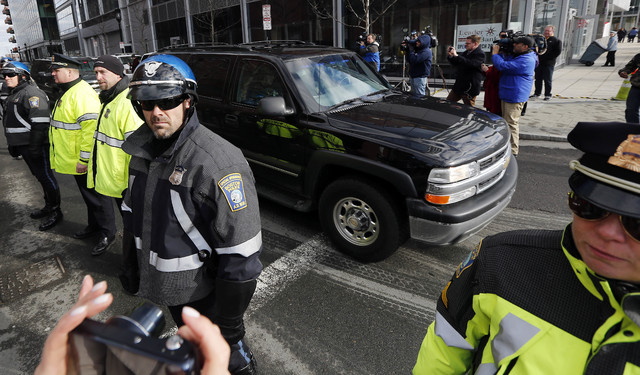 A motorcade carrying Boston Marathon bombing suspect Dzhokhar Tsarnaev rolls away from federal court in Boston Thursday, Dec. 18, 2014, after a final hearing for before his trial begins in January ...