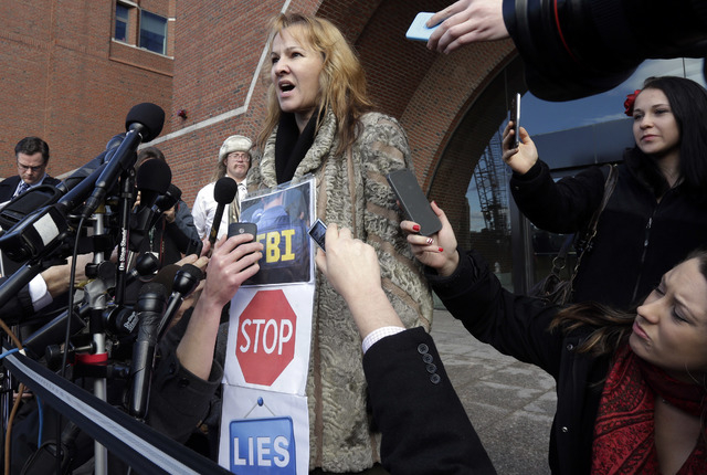 Elena Teyer speaks outside Boston federal court in support of Boston Marathon bombing suspect Dzhokhar Tsarnaev Thursday, Dec. 18, 2014, after a final hearing before his trial begins in January. T ...