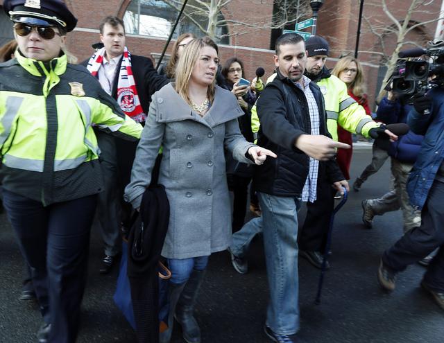 Boston Marathon bombing victim Marc Fucarile, right, leaves federal court in Boston, with his wife, Jen, center, Thursday, Dec. 18, 2014, after a hearing for bombing suspect Dzhokhar Tsarnaev. Tsa ...