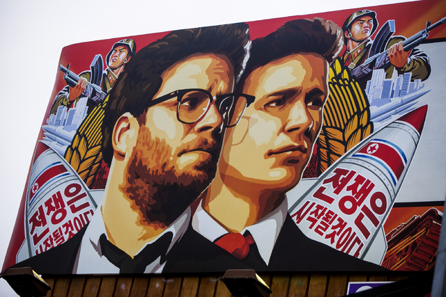 "A banner for ""The Interview"" is posted outside Arclight Cinemas, Wednesday, Dec. 17, 2014, in the Hollywood section of Los Angeles. (AP Photo/Damian Dovarganes)"