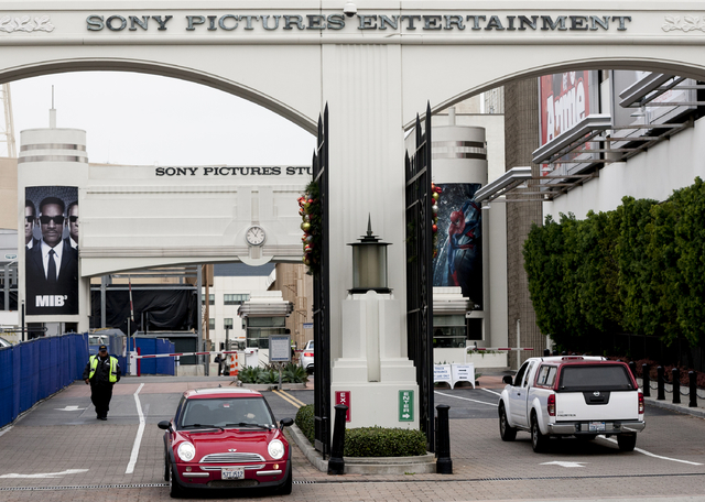 Cars enter and depart from Sony Pictures Entertainment studio lot in Culver City, Calif., Thursday, Dec. 18, 2014. Companies across the globe are on high alert to tighten up network security to av ...