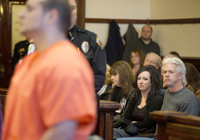 In this Nov. 13, 2014, photo, Jennifer Blaz, 34, center, sits with her parents Tami Windham, 54, left, and Mike Windham, 54, in district court during the sentencing of Matthew Blaz, 33, in Butte,  ...