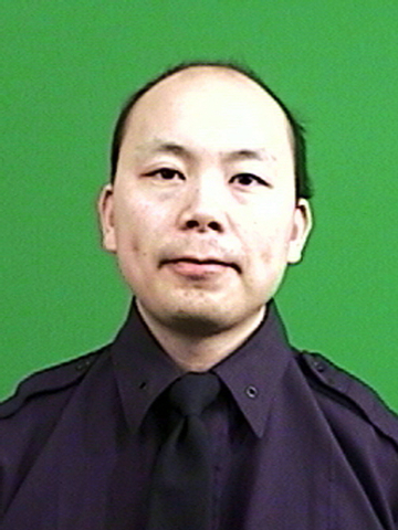 This photo provided by the New York Police Department shows officer Wenjian Liu. Liu and officer Rafael Ramos where shot and killed Saturday, Dec. 20, 2014, in the Brooklyn borough of New York. Th ...