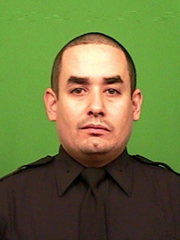 This photo provided by the New York Police Department shows officer Rafael Ramos. Ramos and officer Wenjian Liu where shot and killed Saturday, Dec. 20, 2014, in the Brooklyn borough of New York.  ...