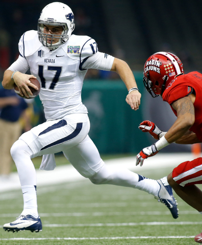 Nevada quarterback Cody Fajardo (17) runs past Louisiana-Lafayette safety Trevence Patt, right, during the first half of the New Orleans Bowl NCAA college football game in New Orleans, Saturday, D ...