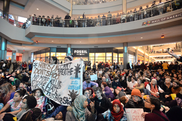 """Demonstrators filled the Mall of America rotunda and chanted """"Black lives matter"""" to protest police brutality, Saturday, Dec. 12, 2014, in Bloomington, Minn.  The group Black Lives Matte ..."""
