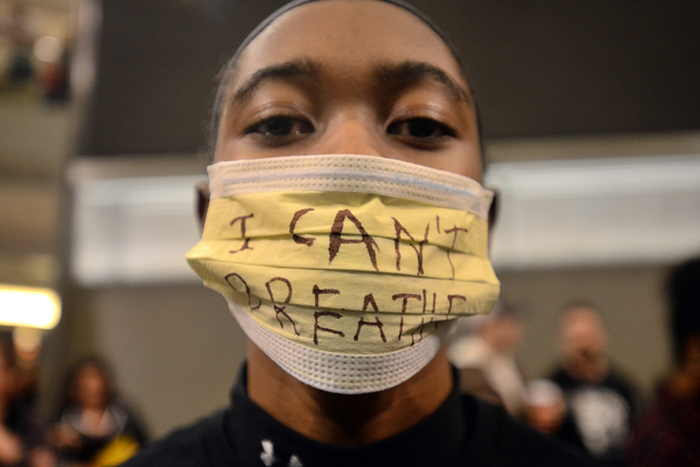 KanKemwa Green of Mankato, Minn participates in a protest at the Mall of America Saturday, Dec. 20, 2014, in Bloomington, Minn. The group Black Lives Matter Minneapolis had more than 3,000 people  ...