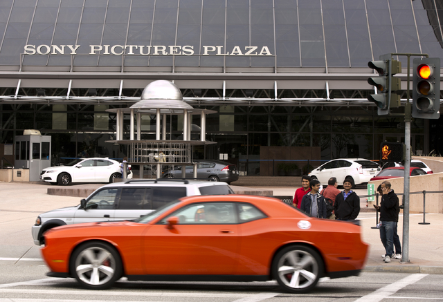 "Cars drive by the Sony Pictures Plaza building in Culver City, Calif., Friday, Dec. 19, 2014. President Barack Obama declared Friday that Sony ""made a mistake"" in shelving the satirical  ..."