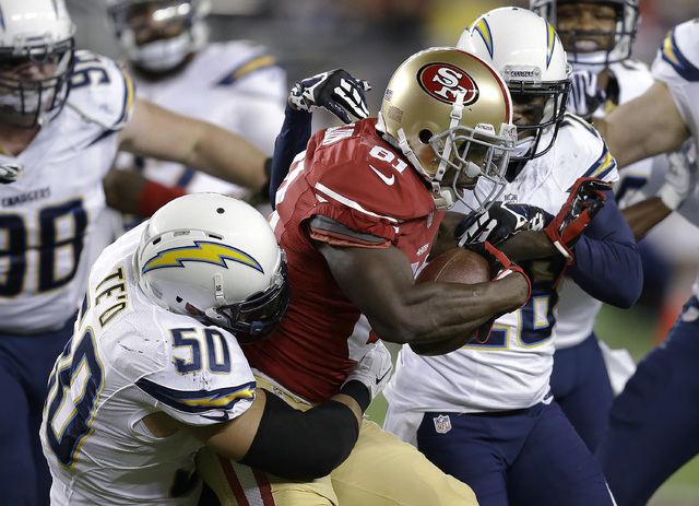 San Francisco 49ers wide receiver Anquan Boldin (81) is tackled by San Diego Chargers inside linebacker Manti Te'o (50) and defensive back Brandon Flowers during the first quarter of an NFL footba ...