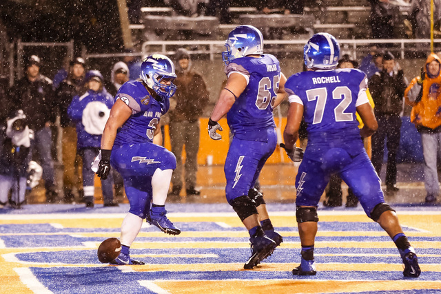 Air Force running back D.J. Johnson (3), offensive linesman Michael Husar (65) and offensive linesman Matt Rochell (72) celebrate Johnson's touchdown during the second half of the Famous Idaho Pot ...