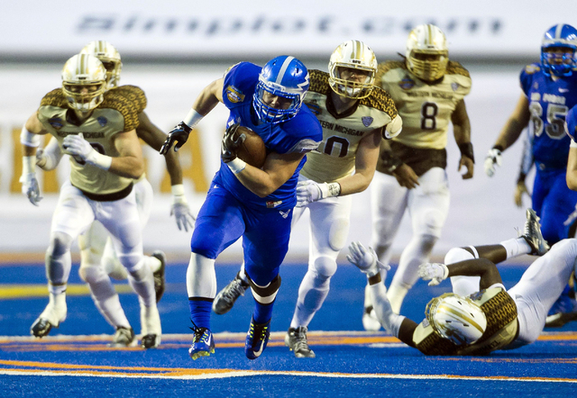 Air Force running back Shayne Davern (43) breaks through the Western Michigan defense and runs for a touch down during the Famous Idaho Potato Bowl NCAA college football game, Saturday, Dec. 20, 2 ...
