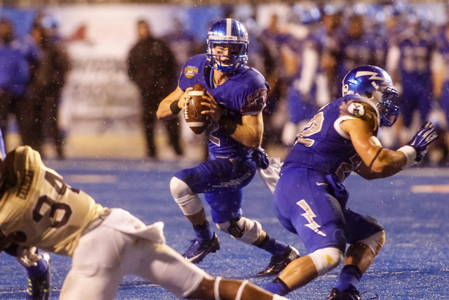 Air Force quarterback Kale Pearson (2) looks for a receiver during the second half of the Famous Idaho Potato Bowl NCAA college football game against Western Michigan in Boise, Idaho, on Saturday, ...