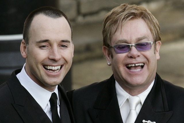 A Wednesday Dec. 21, 2005 photo from files showing pop star Elton John, right, and his longtime partner David Furnish, after they had a civil ceremony at the Guildhall in Windsor, England. (AP Pho ...