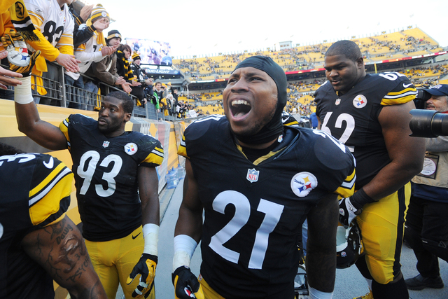 Pittsburgh Steelers safety Robert Golden (21) celebrates as he walks off the field after a 20-12 win over the Kansas City Chiefs in an NFL football game in Pittsburgh, Sunday, Dec. 21, 2014. (AP P ...