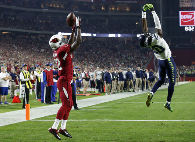 Arizona Cardinals wide receiver John Brown (12) can't make the catch in the end zone against the Seattle Seahawks during the first half of an NFL football game, Sunday, Dec. 21, 2014, in Glendale, ...