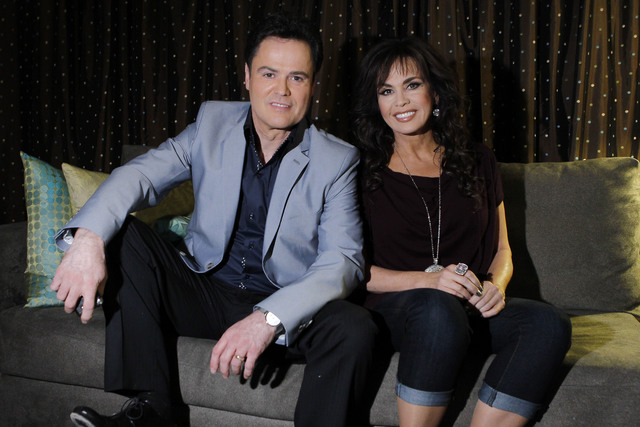 In this April 28, 2011 file photo, siblings Donny Osmond, left, and Marie Osmond pose backstage at their show at the Flamingo hotel and casino in Las Vegas. Donny and Marie Osmond will be singing  ...