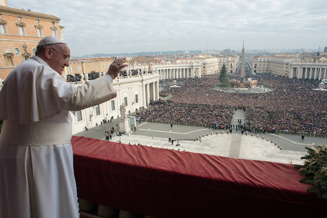 """In this picture provided by the Vatican newspaper L'Osservatore Romano, Pope Francis delivers his """"Urbi et Orbi"""" (to the city and to the world) blessing from the central balcony of St. Peter's Bas ..."""