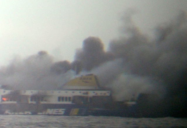 In this photo taken from a nearby ship, smoke rises from the Italian-flagged Norman Atlantic ferry after it caught fire in the Adriatic Sea, Sunday, Dec. 28, 2014. The ferry carrying some hundreds ...