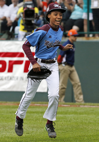 In this Aug. 15, 2014, file photo, Pennsylvania pitcher Mo'ne Davis celebrates after getting the final out of a 4-0 shutout against Tennessee during a baseball game in United States pool play at t ...