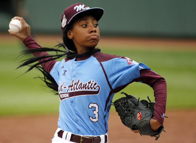 In this Aug. 15, 2014, file photo, Pennsylvania's Mo'ne Davis delivers in the fifth inning against Tennessee during a baseball game in United States pool play at the Little League World Series tou ...