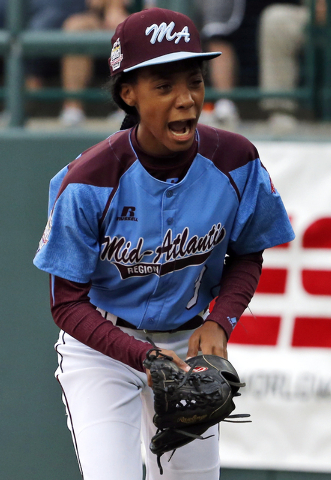 In this Aug. 15, 2014, file photo, Pennsylvania pitcher Mo'ne Davis celebrates after getting the final out in a 4-0 shutout against Tennessee during a baseball game in United States pool play at t ...
