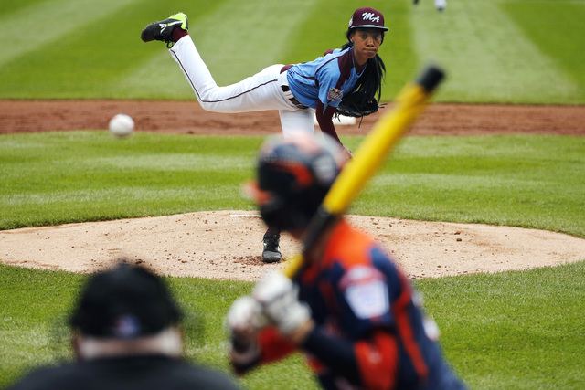 In this Aug. 15, 2014, file photo, Philadelphia's Mo'ne Davis delivers in the first inning against Nashville's Robert Hassell III during a baseball game in U.S. pool play at the Little League Worl ...