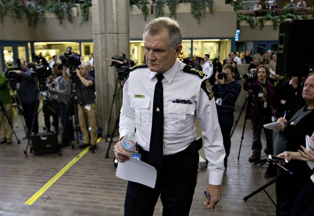 Edmonton City Police Chief Rod Knecht arrives to speak about multiple homicides that took place at different scenes over night in Edmonton, Alberta, Tuesday, Dec. 30, 2014. Police have confirmed t ...