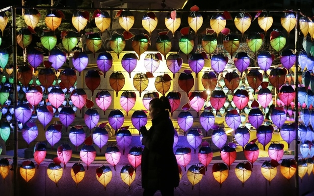 A woman prays during New Year celebrations at Jogye Buddhist temple in Seoul, South Korea, Thursday, Jan. 1, 2015. (AP Photo/Ahn Young-joon)