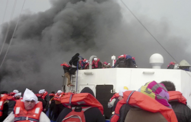 In this image taken from a Dec. 28, 2014 video and made available Wednesday, Dec. 31, 2014 passengers of the Italian-flagged ferry Norman Atlantic wait to be rescued after it caught fire in the Ad ...