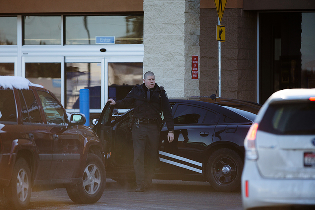 An Idaho State Patrol officer arrives at Wal-Mart in Hayden, Idaho, Tuesday, Dec. 30, 2014. A 2-year-old boy accidentally shot and killed his mother after he reached into her purse at the northern ...