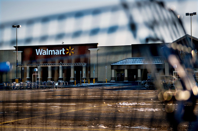 This photo shows Wal-Mart with a shopping cart in the foreground in Hayden, Idaho, Tuesday, Dec. 30, 2014. A 2-year-old boy accidentally shot and killed his mother after he reached into her purse  ...