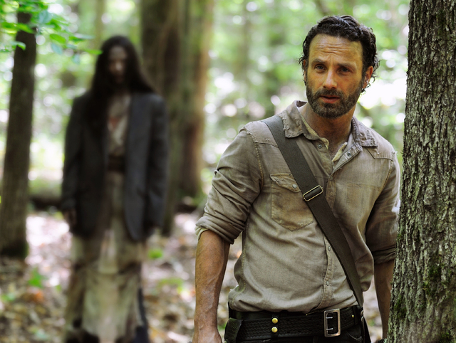 """This image released by AMC shows Andrew Lincoln as Rick Grimes in a scene from the season four premiere of """"The Walking Dead,"""" airing Oct. 13 at 9 p.m. EST. (AP Photo/AMC, Gene Page)"""